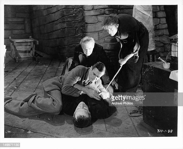 Colin Clive wrestles with Boris Karloff as the monster as others look on in a scene from the film 'Frankenstein' 1931