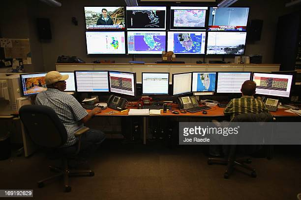 Colin Coppin and Robert Thompson control room operators keep their eyes on the system as they participate in a hurricane response exercise at the...
