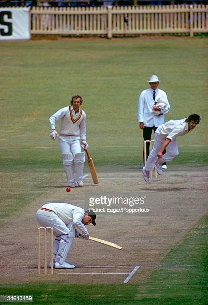 Colin Cowdrey ducks a bouncer from Dennis Lillee David Lloyd is the backingup batsman Australia v England 2nd Test Perth December 197475