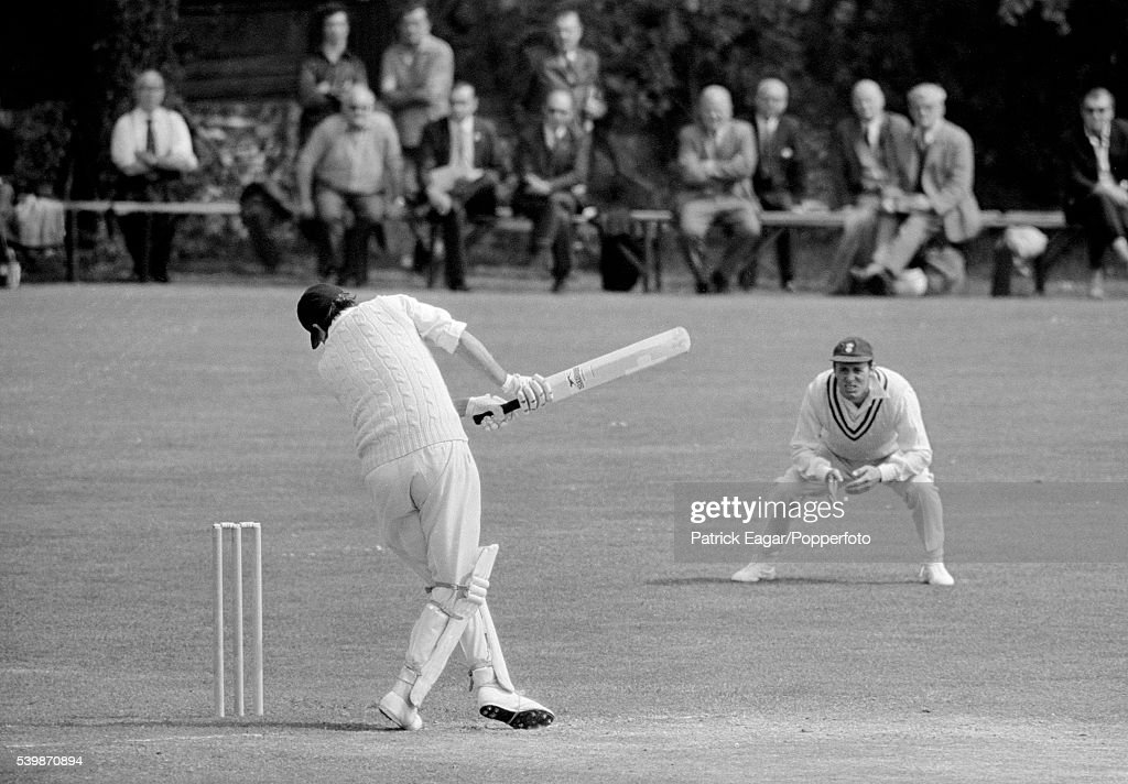 Colin Cowdrey of Kent falls onto his wicket after being struck by a bouncer from Andy Roberts of Hampshire during the County Championship match...