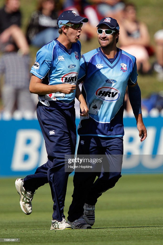 Colin De Grandhomme of Auckland congratulates Matt Quinn after taking a catch to dismiss Ben Orton of Wellington during the HRV Cup Twenty20 Preliminary Final between the Wellington Firebirds and the Auckland Aces at Basin Reserve on January 18, 2013 in Wellington, New Zealand.