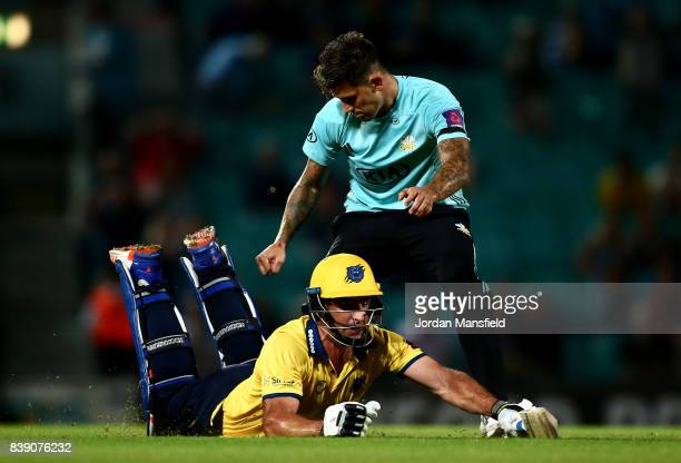 Colin de Grandhomme of Birmingham dives to make his ground as Jade Dernbach of Surrey attempts to run him out during the NatWest T20 Blast...