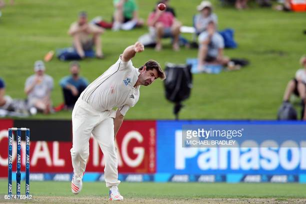 Colin de Grandhomme of New Zealand bowls during day one of the third Test cricket match between New Zealand and South Africa at Seddon Park in...