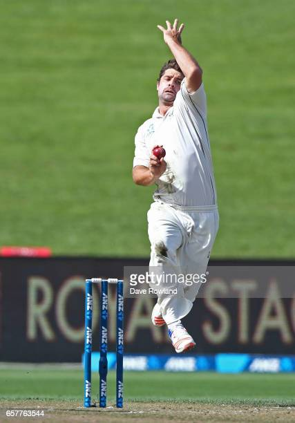 Colin de Grandhomme of New Zealand bowls during day two of the Test match between New Zealand and South Africa at Seddon Park on March 26 2017 in...