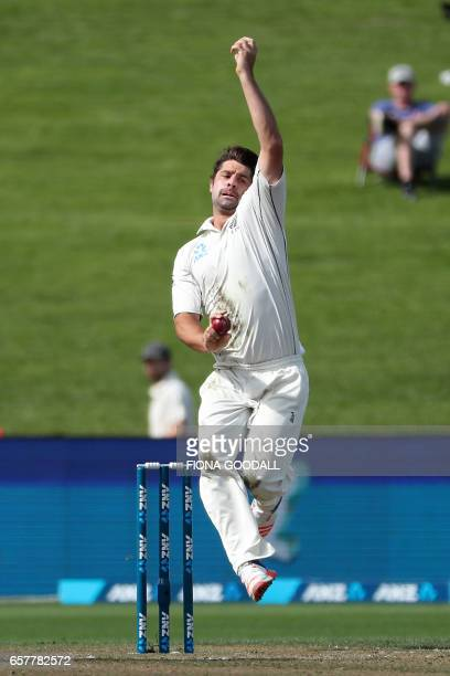 Colin de Grandhomme of New Zealand bowls on day two of the third Test cricket match between New Zealand and South Africa at Seddon Park in Hamilton...