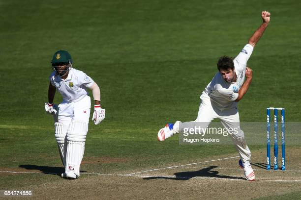 Colin de Grandhomme of New Zealand bowls while Temba Bavuma of South Africa looks on during day two of the test match between New Zealand and South...