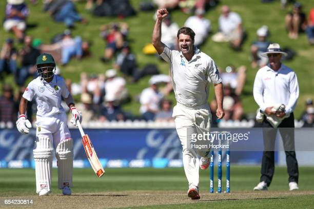 Colin de Grandhomme of New Zealand celebrates after taking the wicket of Faf du Plessis of South Africa during day two of the test match between New...