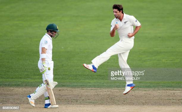 Colin de Grandhomme of New Zealand celebrates the wicket of Dean Elgar of South Africa during day four of the third Test cricket match between New...