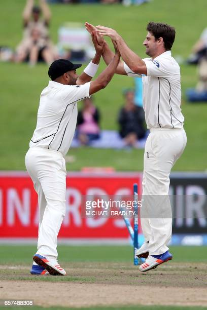 Colin de Grandhomme of New Zealand celebrates with teammate Jeetan Patel after Hashim Amla from South Africa is dismissed during day one of the third...
