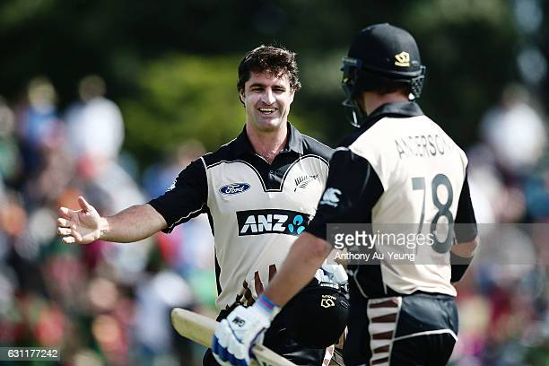 Colin de Grandhomme of New Zealand congratulates teammate Corey Anderson after their innings during the third Twenty20 International match between...