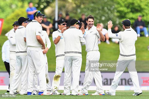 Colin de Grandhomme of New Zealand is congratulated by team mates after dismissing Azhar Ali of Pakistan during day two of the First Test between New...