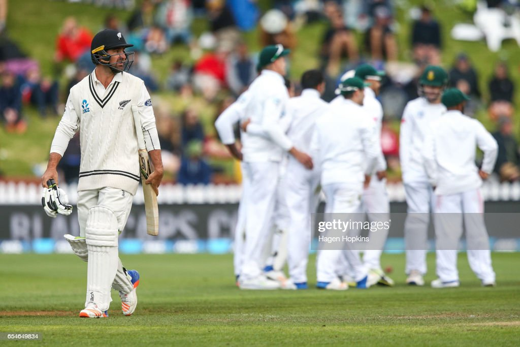 Colin de Grandhomme of New Zealand looks at a replay on the big screen after being dismissed during day three of the test match between New Zealand and South Africa at Basin Reserve on March 18, 2017 in Wellington, New Zealand.