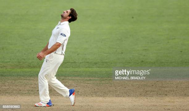 Colin de Grandhomme of New Zealand reacts after bowling during day four of the third Test cricket match between New Zealand and South Africa at...