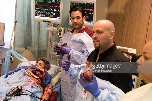 Colin Donnell and Dr Andrew Dennis attend the behindthescenes set visits during NBC's Chicago series press day on October 24 2016 in Chicago Illinois