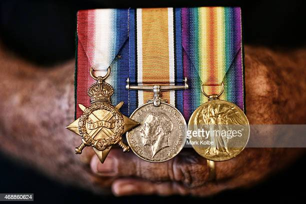 Colin Doust the son ANZAC veteran Robert Bob Doust who served in the Australian armed forces at Gallipoli in 1915 holds his fathers service medals as...