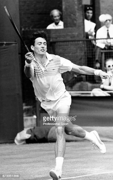 Colin Dowdeswell of Great Britain in action during the Men's Singles Wimbledon Championships held at the All England Lawn Tennis and Croquet Club in...