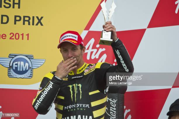 Colin Edwards of USA and Monster Yamaha Tech 3 celebrates the third place on the podium at the end of the MotoGP race of MotoGp Of Great Britain at...
