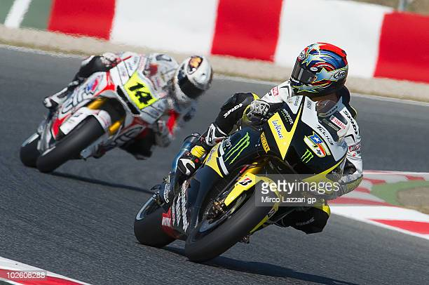Colin Edwards of USA and Monster Yamaha Tech 3 leads Randy De Puniet of France and LCR Honda MotoGP during the qualifying practice session of MotoGP...