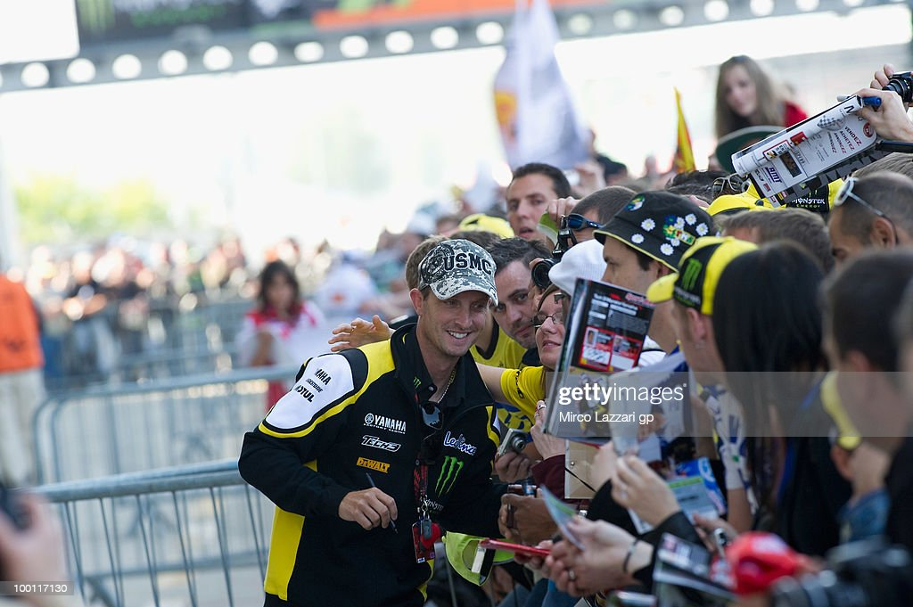 Colin Edwards of USA and Monster Yamaha Tech 3 signs autographs for fans during the 'Pit Lane Walk' of the MotoGP French Grand Prix in Le Mans Circuit on May 21, 2010 in Le Mans, France.