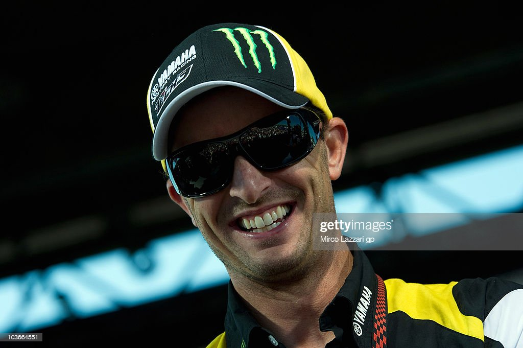 <a gi-track='captionPersonalityLinkClicked' href=/galleries/search?phrase=Colin+Edwards&family=editorial&specificpeople=240253 ng-click='$event.stopPropagation()'>Colin Edwards</a> of USA and Monster Yamaha Tech 3 smiles in front of fans during the 'Riders for Health Charity Auction' during the Red Bull Indianapolis Moto GP at Indianapolis Motor Speedway on August 27, 2010 in Indianapolis, Indiana.