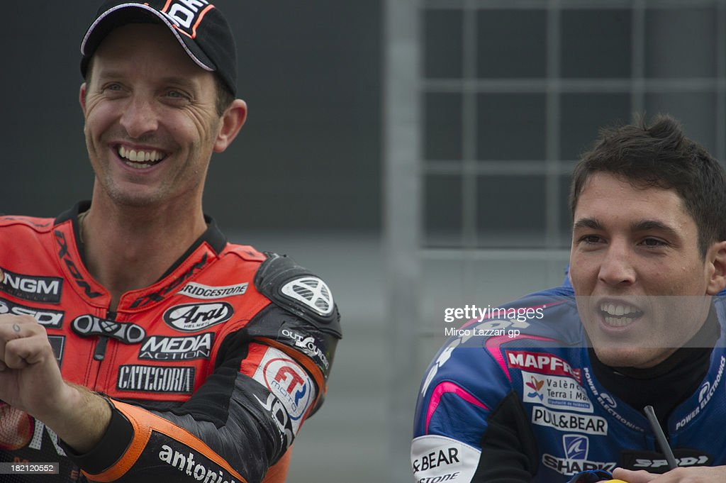 <a gi-track='captionPersonalityLinkClicked' href=/galleries/search?phrase=Colin+Edwards&family=editorial&specificpeople=240253 ng-click='$event.stopPropagation()'>Colin Edwards</a> of USA and NGM Mobile Forward Racing and <a gi-track='captionPersonalityLinkClicked' href=/galleries/search?phrase=Aleix+Espargaro&family=editorial&specificpeople=5550804 ng-click='$event.stopPropagation()'>Aleix Espargaro</a> of Spain and Power Electronics Aspar smile in pit during the MotoGP of Spain - Qualifying at Motorland Aragon Circuit on September 28, 2013 in Alcaniz, Spain.