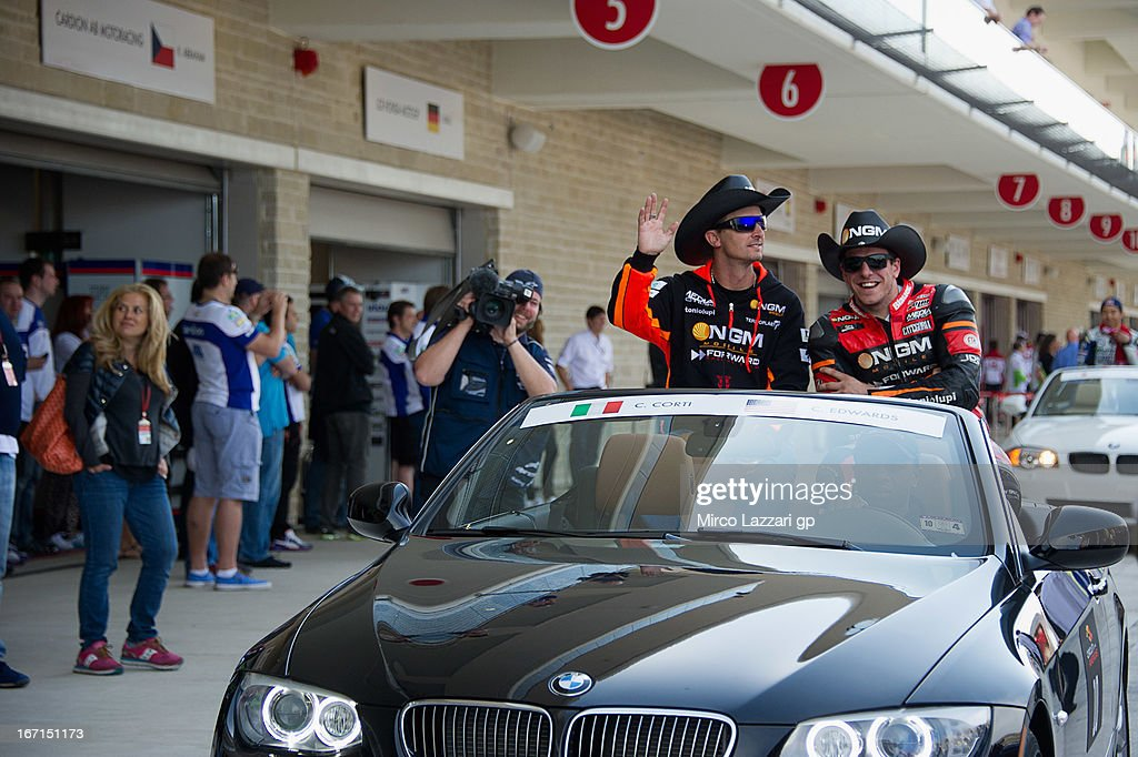 <a gi-track='captionPersonalityLinkClicked' href=/galleries/search?phrase=Colin+Edwards&family=editorial&specificpeople=240253 ng-click='$event.stopPropagation()'>Colin Edwards</a> of USA and NGM Mobile Forward Racing (L) and Claudio Corti of Italy and NGM Mobile Forward Racing greets the fans during the MotoGP parade before the MotoGP race during the MotoGp Red Bull U.S. Grand Prix of The Americas - Race at Circuit of The Americas on April 21, 2013 in Austin, Texas.