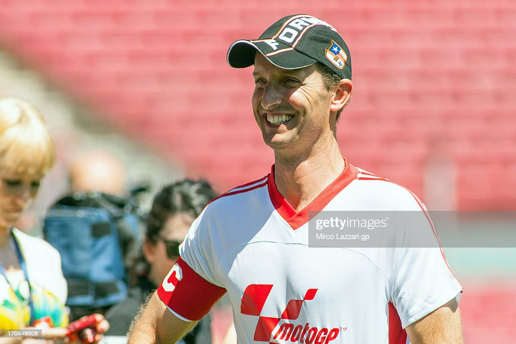 <a gi-track='captionPersonalityLinkClicked' href=/galleries/search?phrase=Colin+Edwards&family=editorial&specificpeople=240253 ng-click='$event.stopPropagation()'>Colin Edwards</a> of USA and NGM Mobile Forward Racing smiles during the pre-event 'Friendly match between a MotoGP team and a Moto2 and Moto3 Team' at FC Barcelona's Nou Camp during the MotoGp Of Catalunya - Previews at Circuit de Catalunya on June 13, 2013 in Montmelo, Spain.