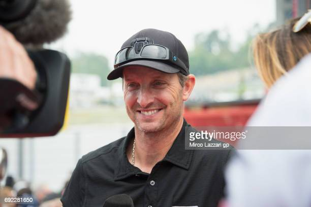 Colin Edwards of USA speaks on TV during the MotoGP race during the MotoGp of Italy Race at Mugello Circuit on June 4 2017 in Scarperia Italy