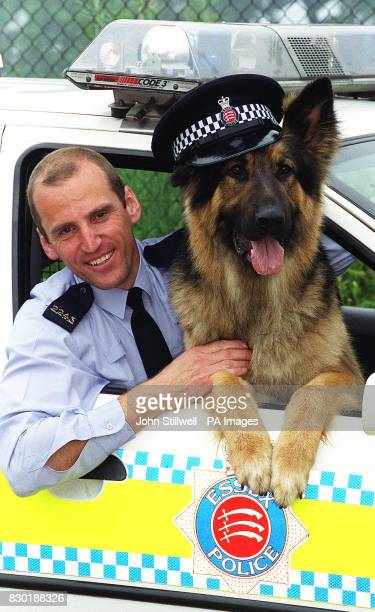 PC Colin Elsegood with his dog 'Blade' at the Essex Police dog training centre at Sandon near Chelmsford The Essex Police force showed their dogs to...