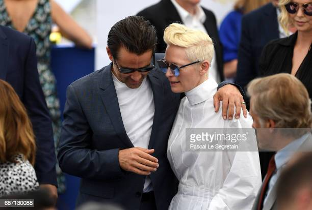 Colin Farrell and Tilda Swinton attend the 70th Anniversary Photocall during the 70th annual Cannes Film Festival at Palais des Festivals on May 23...
