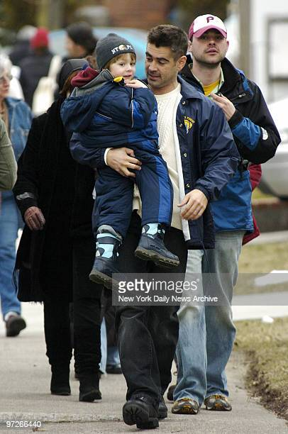 Colin Farrell carries Ty Simpkins on Leggett Place in Whitestone Queens where they are filming scenes for their new movie 'Pride and Glory' Simpkins...