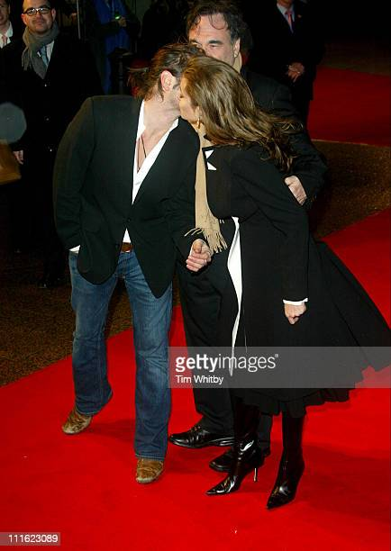Colin Farrell Oliver Stone and Angelina Jolie during 'Alexander' London Premiere Arrivals at Odeon Leicester Square in London Great Britain
