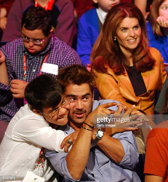 Colin Farrell plays with student Luis Aguilera at the Special Olympics Global Youth Forum at the Helix Theatre in DCU on June 23 2003 in Dublin...