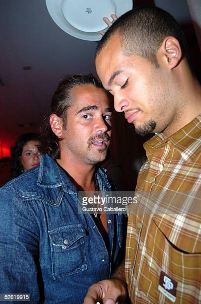 Colin Farrell poses with his bodyguard at Pearl Nightclub and Lounge while in Miami Beach filming 'Miami Vice' movie March 28 2005 in Miami Beach