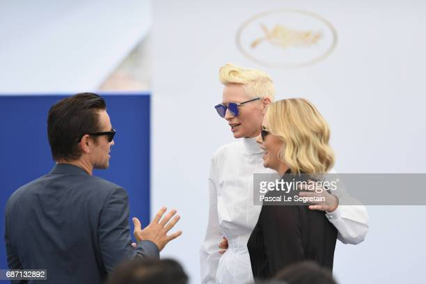 Colin Farrell Tilda Swinton and Charlize Theron attend the 70th Anniversary Photocall during the 70th annual Cannes Film Festival at Palais des...