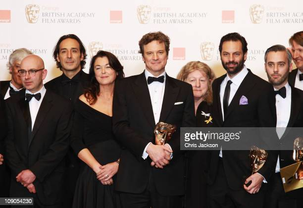 Colin Firth and the cast and crew pose with the award for Best Film for the film 'The King's Speech' during the 2011 Orange British Academy Film...