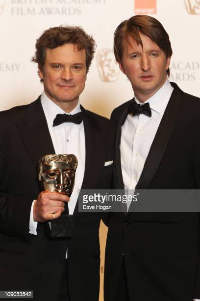 Colin Firth and Tom Hooper pose with the Best Film award for The Kings Speech in front of the winners boards at the Orange British Academy Film...