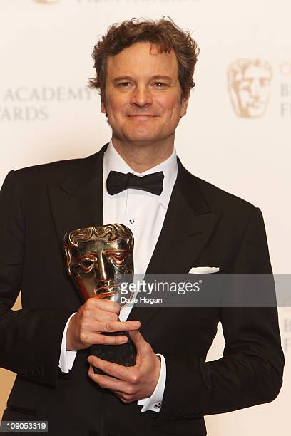 Colin Firth poses with his Best Actor award in front of the winners boards at the Orange British Academy Film Awards 2011 held at The Royal Opera...