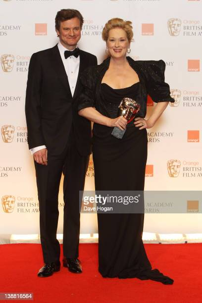 Colin Firth poses with Meryl Streep after presenting her with the Best Actress Award in the press room at The Orange British Academy Film Awards 2012...