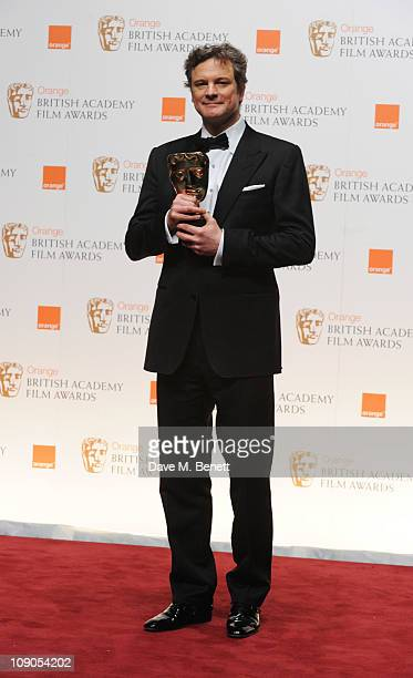 Colin Firth poses with the Leading Actor Award and Best Film Award for The King's Speech during the Orange British Academy Film Awards 2011 at The...
