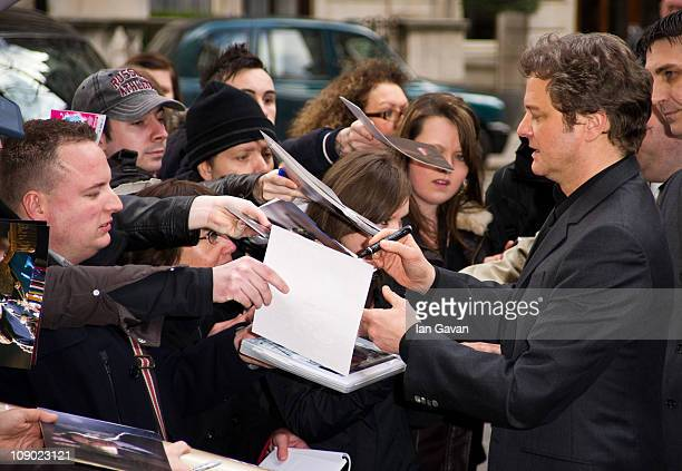 Colin Firth signs autographs for fans as he arrives to attend the British Academy Film Awards Nominees Brunch at the Corinthia Hotel London on...