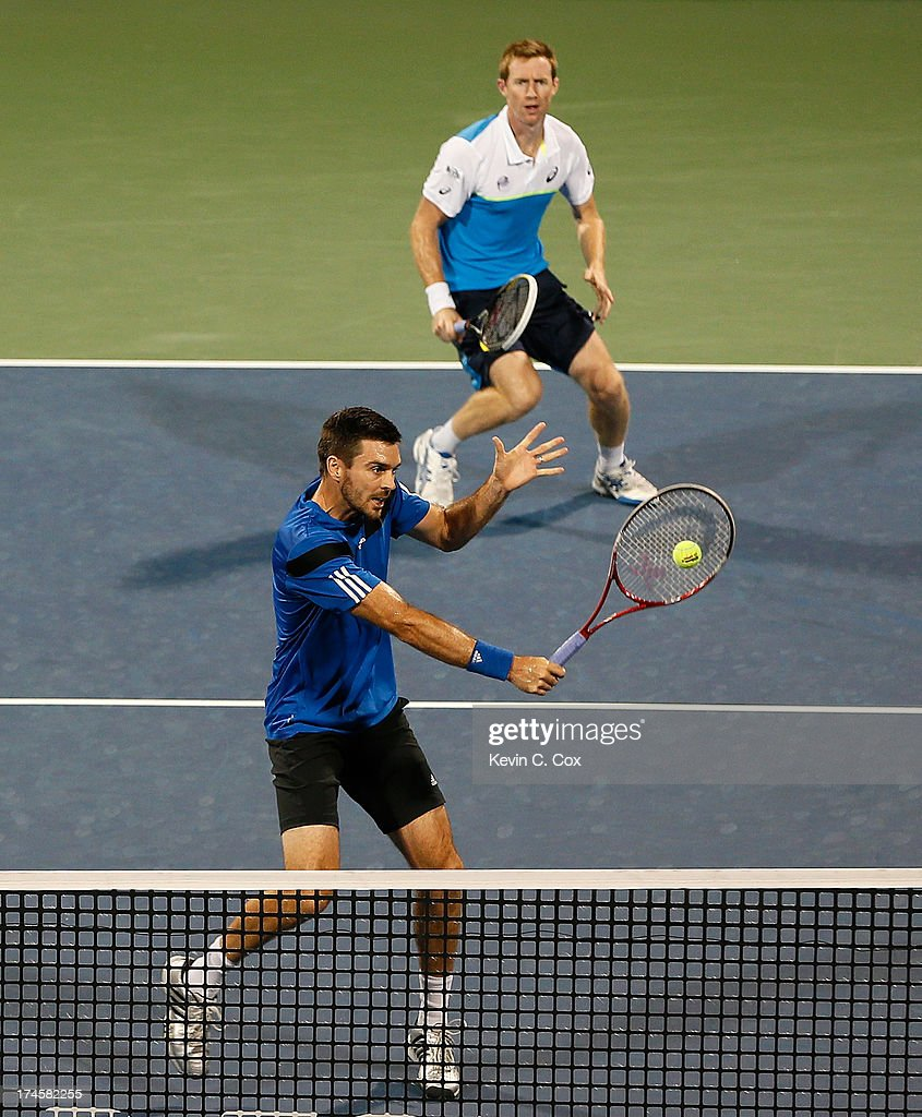 Colin Fleming and Jonathan Marray, both of Great Britain, return a shot to Chris Guccione and Lleyton Hewitt, both of Australia, during the BB&T Atlanta Open in Atlantic Station on July 27, 2013 in Atlanta, Georgia.