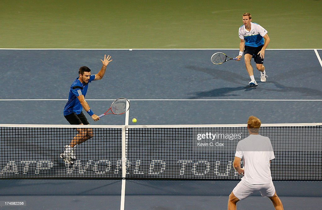 Colin Fleming and <a gi-track='captionPersonalityLinkClicked' href=/galleries/search?phrase=Jonathan+Marray&family=editorial&specificpeople=210685 ng-click='$event.stopPropagation()'>Jonathan Marray</a>, both of Great Britain, return a shot to Chris Guccione and Lleyton Hewitt, both of Australia, during the BB&T Atlanta Open in Atlantic Station on July 27, 2013 in Atlanta, Georgia.