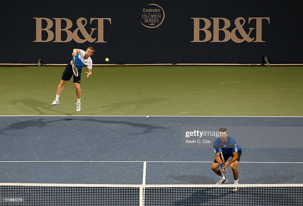 Colin Fleming and <a gi-track='captionPersonalityLinkClicked' href=/galleries/search?phrase=Jonathan+Marray&family=editorial&specificpeople=210685 ng-click='$event.stopPropagation()'>Jonathan Marray</a>, both of Great Britain, serve to Chris Guccione and Lleyton Hewitt, both of Australia, during the BB&T Atlanta Open in Atlantic Station on July 27, 2013 in Atlanta, Georgia.