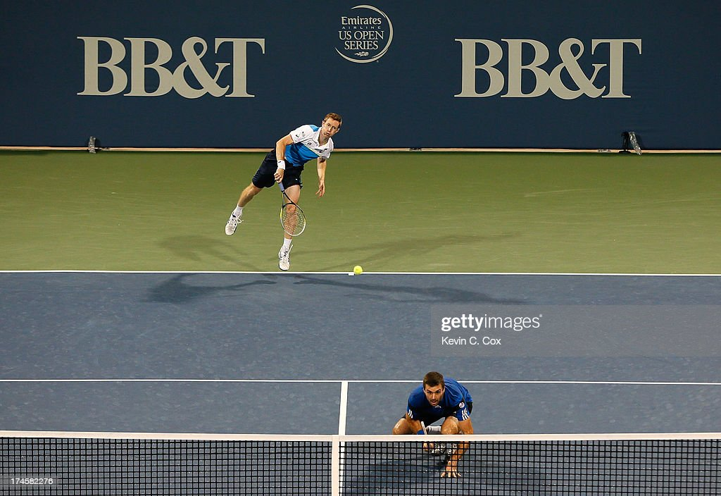 Colin Fleming and Jonathan Marray, both of Great Britain, serve to Chris Guccione and Lleyton Hewitt, both of Australia, during the BB&T Atlanta Open in Atlantic Station on July 27, 2013 in Atlanta, Georgia.