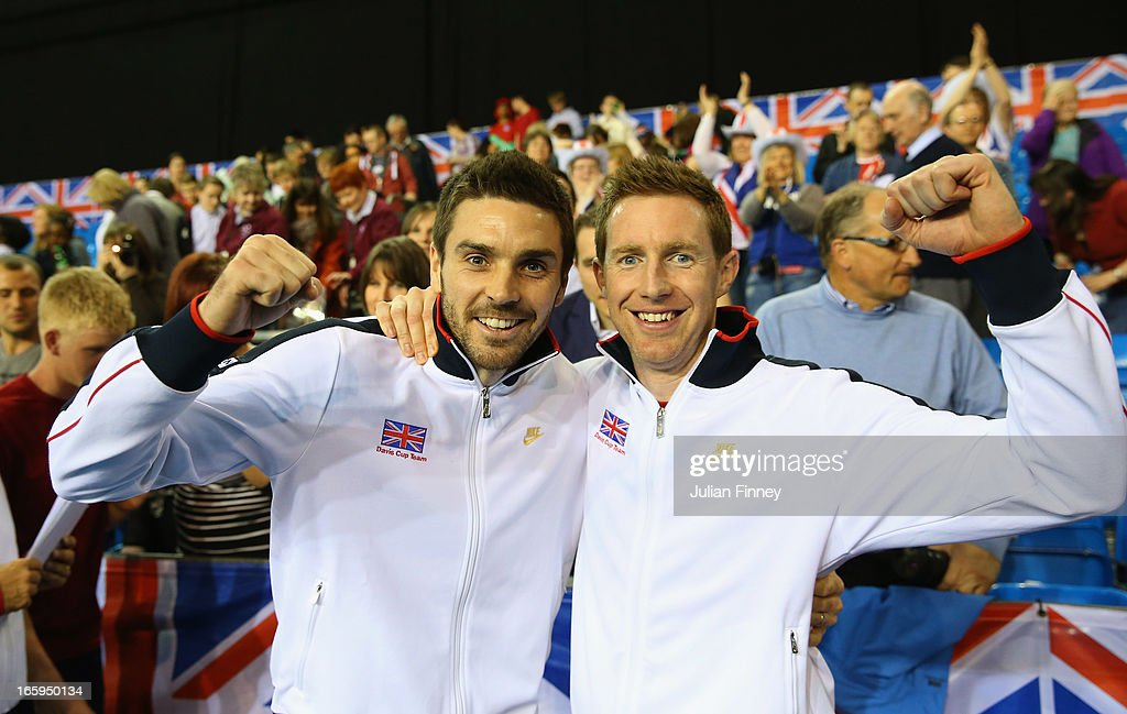 Colin Fleming and <a gi-track='captionPersonalityLinkClicked' href=/galleries/search?phrase=Jonathan+Marray&family=editorial&specificpeople=210685 ng-click='$event.stopPropagation()'>Jonathan Marray</a> of Great Britain celebrate their teams success over Russia during day three of the Davis Cup match between Great Britain and Russia at the Ricoh Arena on April 7, 2013 in Coventry, England.