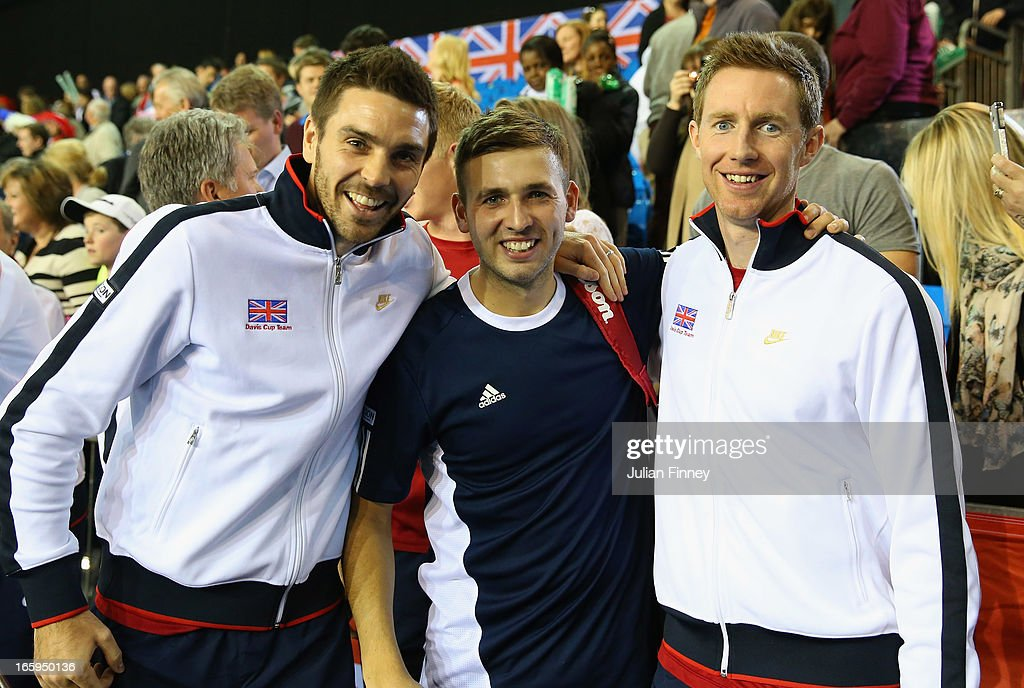 Colin Fleming and <a gi-track='captionPersonalityLinkClicked' href=/galleries/search?phrase=Jonathan+Marray&family=editorial&specificpeople=210685 ng-click='$event.stopPropagation()'>Jonathan Marray</a> of Great Britain celebrate with Dan Evans of Great Britain after their teams success over Russia during day three of the Davis Cup match between Great Britain and Russia at the Ricoh Arena on April 7, 2013 in Coventry, England.