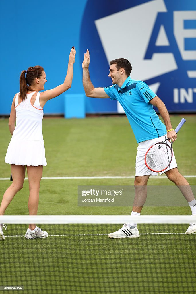 Colin Fleming of Great Britain and Agnieszka Radwanska of Poland celebrate after winning a game during the Rally for Bally exhibtion match against Petra Kvitova of the Czech Republic and Greg Rusedski of Great Britain on day two of the Aegon International at Devonshire Park on June 15, 2014 in Eastbourne, England.