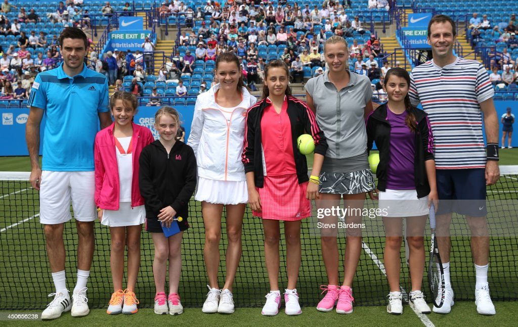 Colin Fleming of Great Britain and Agnieszka Radwanska of Poland play Greg Rusedski of Great Britain and Petra Kvitova of the Czech Republic pose with local children before the Rally for Bally mixed doubles charity match on day two of the Aegon International at Devonshire Park on June 15, 2014 in Eastbourne, England.