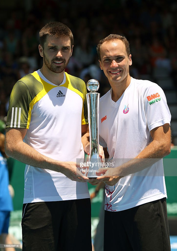 Colin Fleming of Great Britain (L) and Bruno Soares of Brazil (R) hold the trophy following their doubles final against Johan Brunstrom of Sweden and Frederik Nielsen of Denmark during day six of the Heineken Cup at ASB Tennis Centre on January 12, 2013 in Auckland, New Zealand.